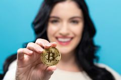 woman-holding-physical-bitcoin-woman-holding-physical-bitcoin-cryptocurrency-her-hand-106247745